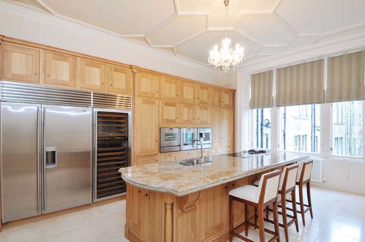 Callerton Traditional True Oak Kitchen Featuring The Classic Feature Pilasters with the Sandown In-Frame Shaker True Oak Door