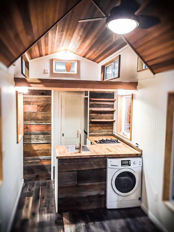 This is the Kootenay tiny house on wheels by Green Leaf Tiny Homes. From  the outside, you'll notice half of the house features stained wooden sidin