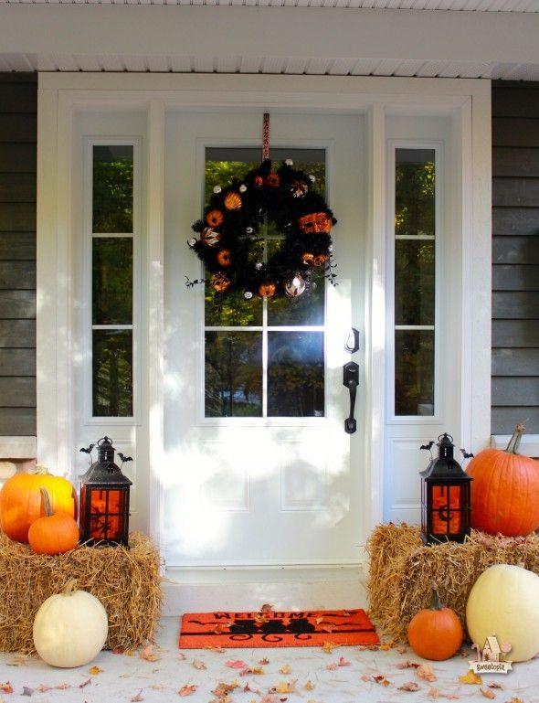 HALLOWEEN -- hay bales, lantern (painted black) and pumpkins, in front corner of the yard.