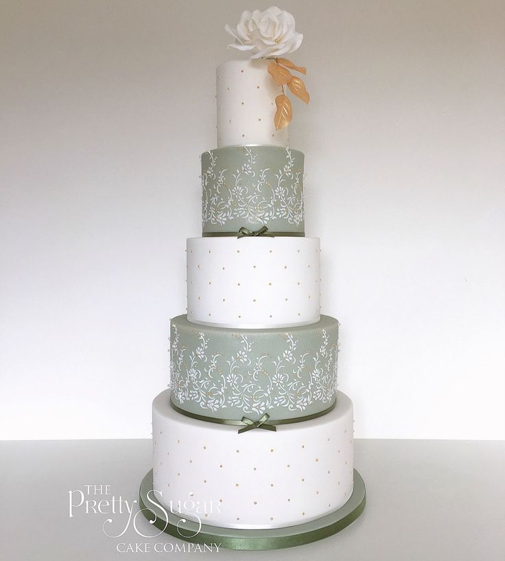 Green and white Asian wedding cake with lace work, pearls and gold embellishment detail
