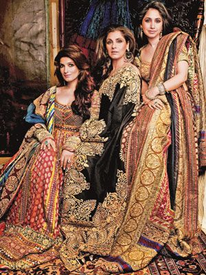Dimple Kapadia with Twinkle Khanna and Rinke Saran          wearing designs by Abu Jani-Sandeep Khosla.
