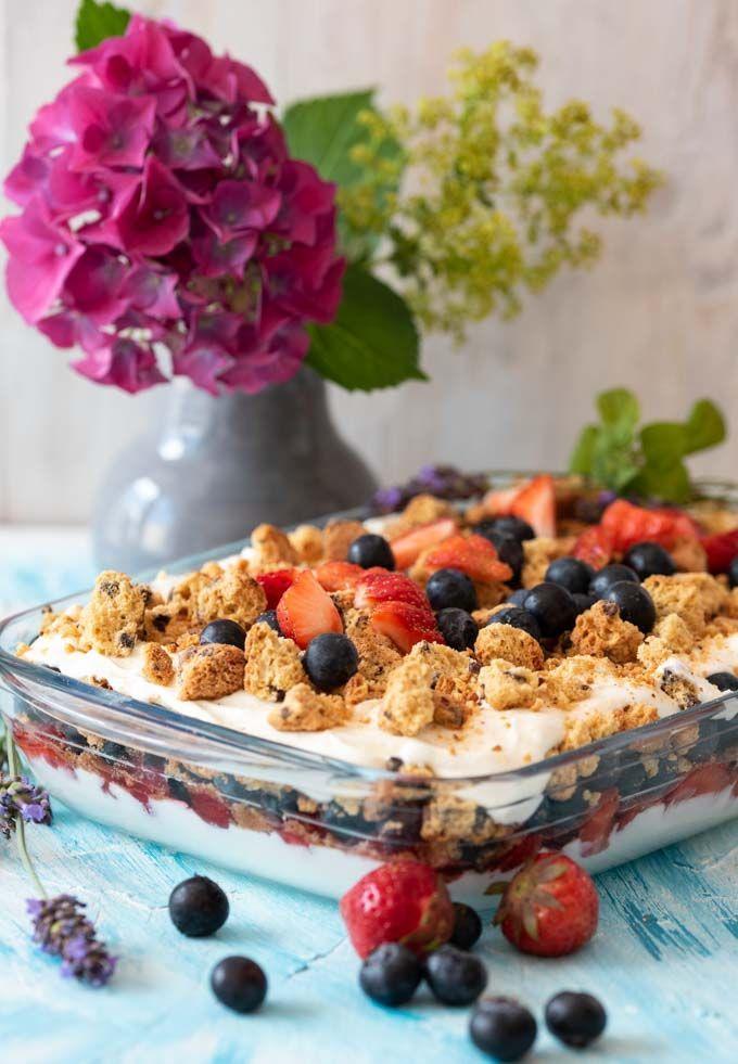Summery light layered dessert with strawberries, …
