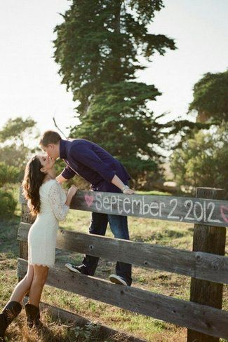 Chalk Fence Save The Date Photo Idea. See more here: 27 Cute Save the Date Photo Ideas | Confetti Daydreams ♥ ♥ ♥ LIKE US ON FB: www.facebook.com/confettidaydreams ♥ ♥ ♥ #Wedding #SaveTheDate #PhotoIdeas