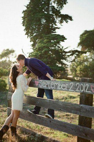 Chalk Fence Save The Date Photo Idea. See more here: 27 Cute Save the Date Photo Ideas | Confetti Daydreams ♥  ♥  ♥ LIKE US ON FB: www.facebook.com/confettidaydreams  ♥  ♥  ♥ #Wedding #SaveTheDate #PhotoIdeas