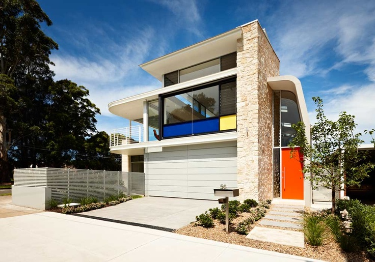 Five Dock Retro House in Sydney. This modern version of a retro home, with curved steel and walls of glass with a hint of Mondrian inspired colour, featured in Episode 3, Grand Designs Australia Series 2.