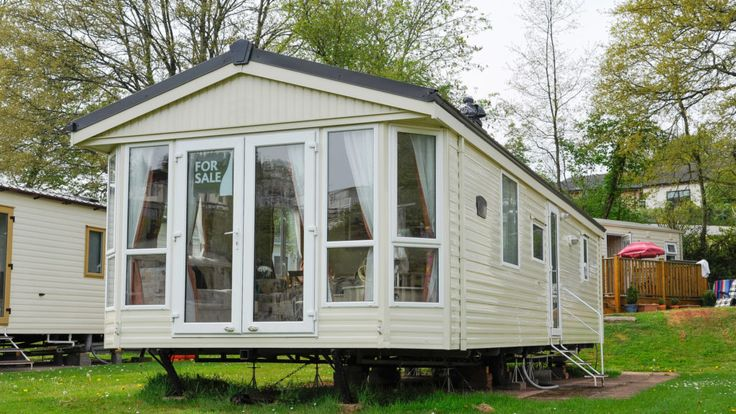 Mobile homes—or manufactured homes—are affordable but not exactly cheap. Which begs the question: How do you get a loan for a mobile home?