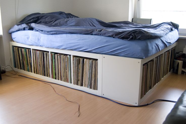 IKEA Hackers: EXPEDIT Bed Frame. Awesome! Such a good way to save space. I'd use this to store clothes instead of records though. #bed #diy #ikeahack