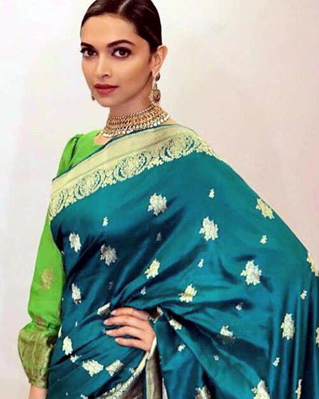 The extremely charismatic and epitome of beauty Deepika Padukone spotted at the event in Vijayawada for Social Media Summit & Awards. Isn't she looks beautiful in this green sari?  #deepikapadukone #stunning
