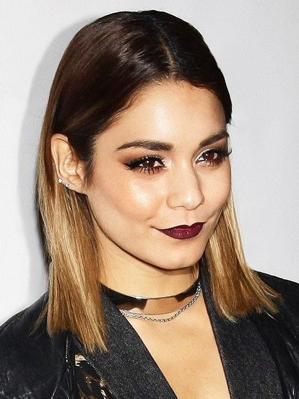 Vanessa Hudgens embraced the darker side of fall beauty with bold brows, black winged eyeliner, and aubergine lips.