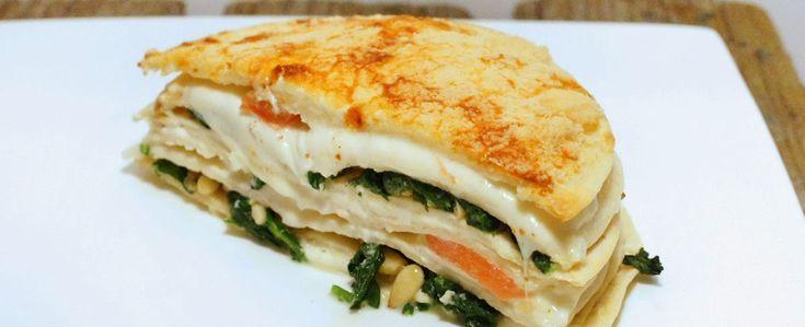 Vega: Tortillataart met spinazie, mascarpone, tomaat, mozzarella, pijnboompitten en een kaaskorst