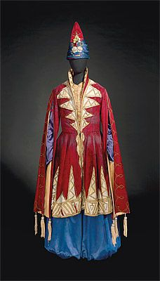 Léon BAKST  designer Belarus (Russia) 1866 – France 1924  France from 1912    producer 1909 – 1929    Marie MUELLE  costumier France      Costume for Shah Shahriar 1910–30s  coat: silk velvet and appliqué, lamé, metallic braid, painted wooden beads, rayon satin; trousers: rayon satin; hat: silk velvet, rayon, glass and metal imitation jewels  Purchased 1973  National Gallery of Australia, Canberra  NGA 1973.270.50.A-C