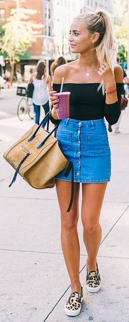 off the shoulder top. denim skirt. and those shoes. Hair tied up.