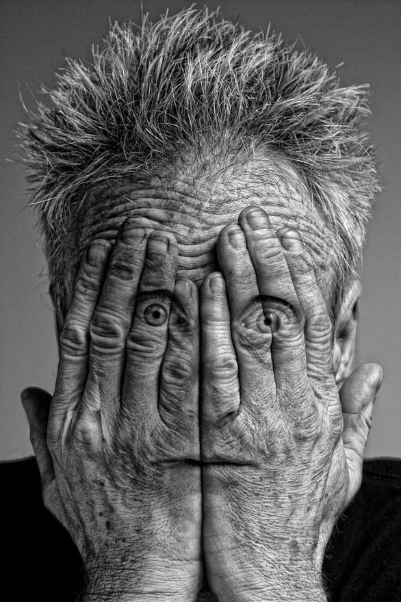 Face through hands, digital manipuation, illusion, black & white, B, strange, weird, odd, man, eyes, human