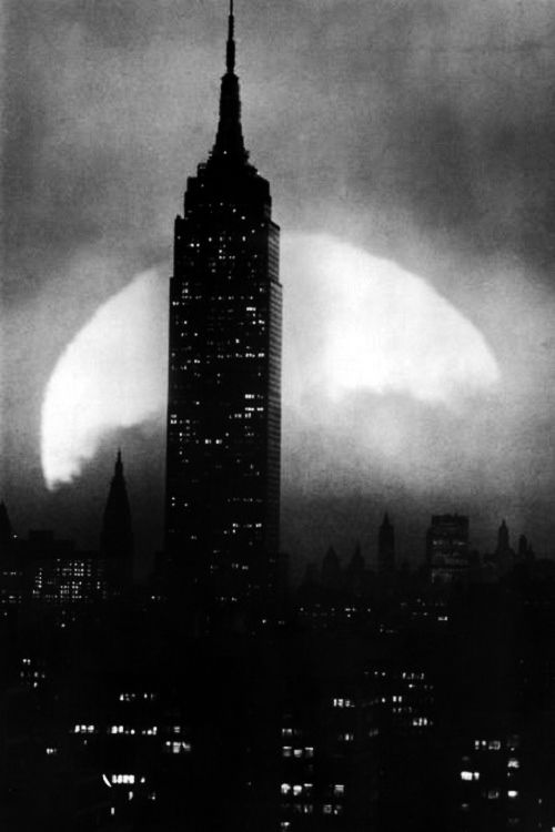 The Empire State Building in front of an ascending full moon, 1930's. °