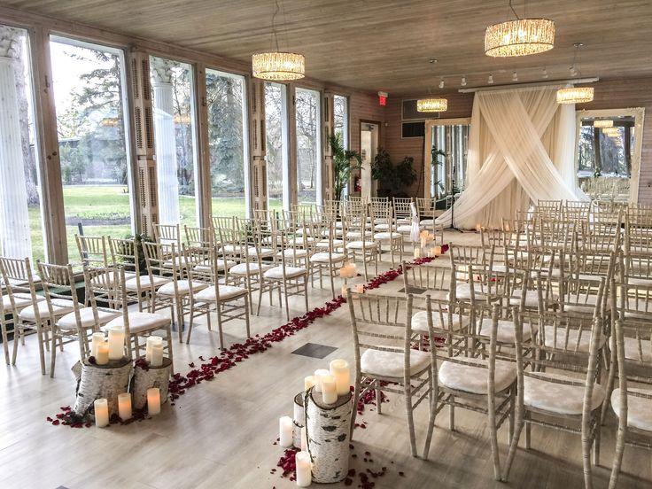 Norland Ballroom Wedding Ceremony  #lachefs #lachefsdecor #thenorland #norlandballroom #simplysurreal #weddingceremony #gardenview #ceremony #wedding #chiavari #aisle #backdrop #logs #rosepetals #mirrorbackdrop #ivory