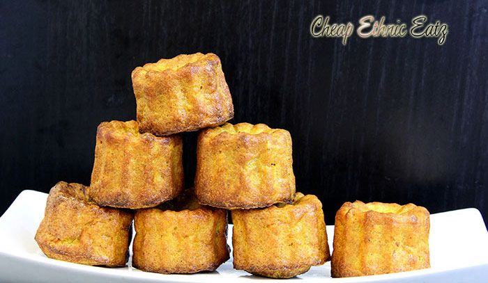 Savory Carrot Curry Canelés are wonderful flavor packed curry bites, beautifully baked in a quintessential French fluted shape.