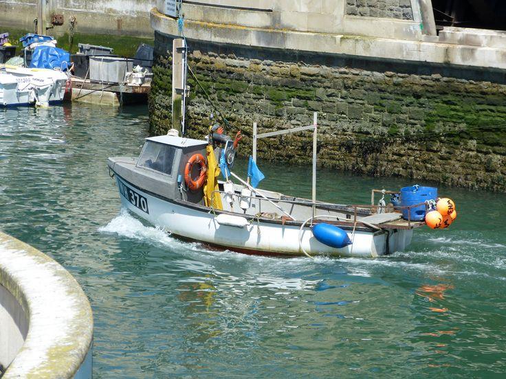 Boat passing through Weymouth harbour bridge