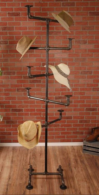 "William Roberts Vintage Industrial Style Hat Rack  This Industrial Style Vintage Hat Rack is made to last forever. Using up-cycled 3/4 black pipe and 3/4 Iron pipe fittings, this heavy duty clothing rack will last a lifetime. Our clothing racks are great for use in retail stores or for extra storage in your home.  Features:  ¾"" Black Pipe and Fittings  4 Flange Feet  Holds 10 Hats  Storable  Industrial Vintage Look  Made in the USA with Global Products Dimensions:  Width – 25 inches …"