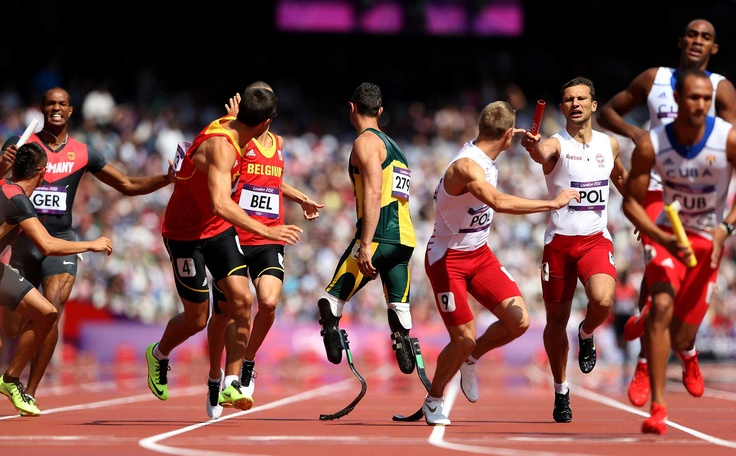 The 24 Most Inspiring Photos of 2012 // Oscar Pistorius of South Africa waits for the baton during the Men's 4 x 400m Relay of the London 2012 Olympic Games on August 9, 2012.