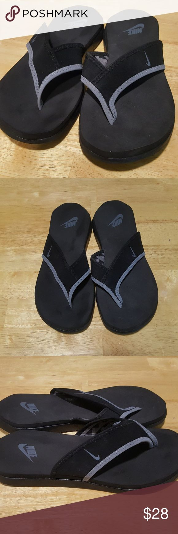 NWOT / NIKE black & grey flip flops the perfect flip flop from NIKE. black & grey flip flops w/ neoprene strap. size: 7.  NWOT condition  THANK-YOU! OPEN TO OFFERS ANY QUESTIONS?...JUST ASK CHECK OUT MY OTHER LISTINGS NIKE Shoes Sandals