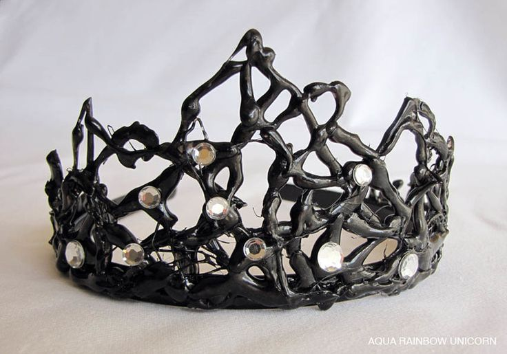 Handmade crown, hot glue gun over a glass plate or sheet of heavier plastic, design underneath.   Let cool and spray paint or brush on acrylic