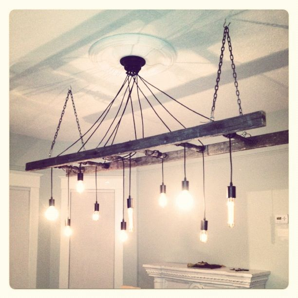 Finished Edison chandelier. Very reclaimed and industrial light fixture.  Turned out perfect! Old ladder. Edison bulbs. Www.bvintage.ca