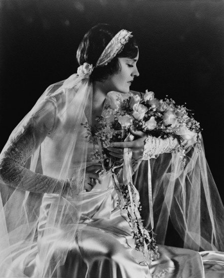 1930's wedding gown. I just love the opulence of the gowns, the veils, the flowers, the photography, the all! It was an extravagant time for so many!