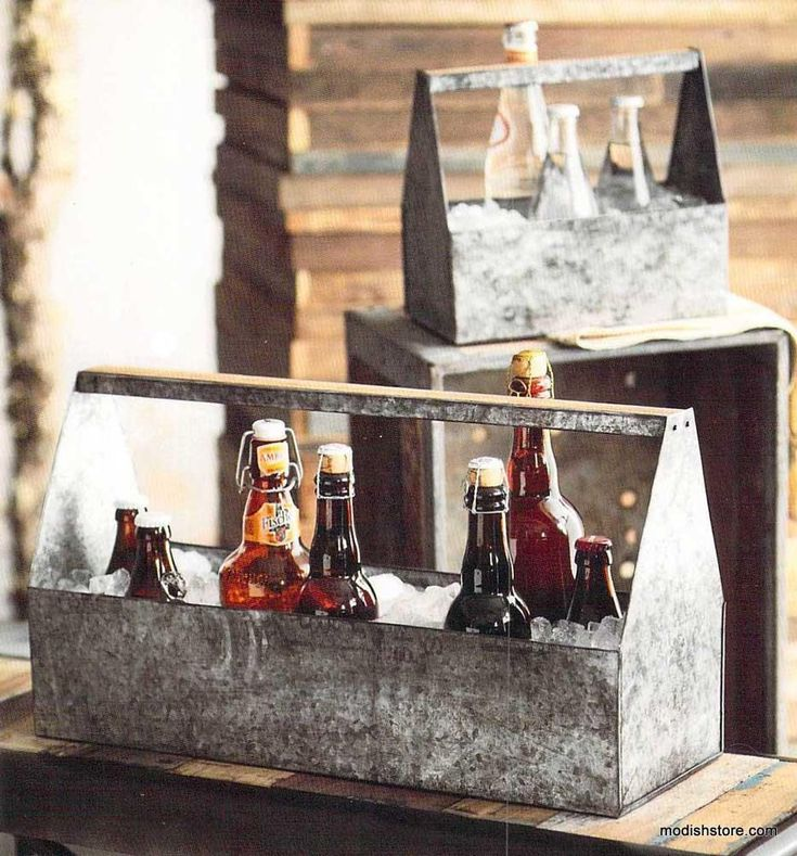 $99.00 Roost Galvanized Thirst Ice Caddies - Set Of 2 Cool galvanized iron sheet with an antique finish and wood accents shape these pieces. Use the thirst Ice Caddies as tabletop party buckets or utensil holders.