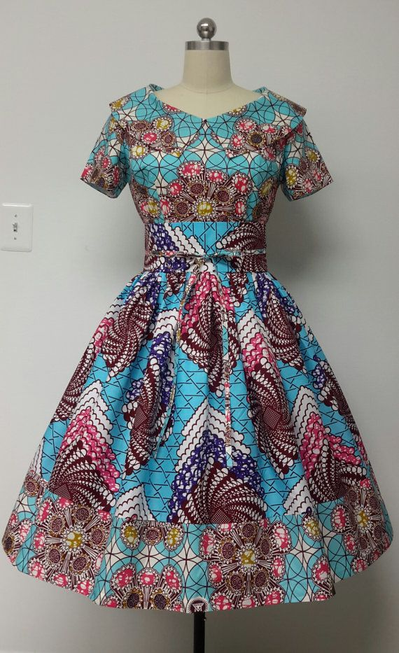 This is a fully lined multi fabric fitted waistline dress with rolled collar, Obi sash, and attached petticoat. INCLUDED: • One dress and One Obi