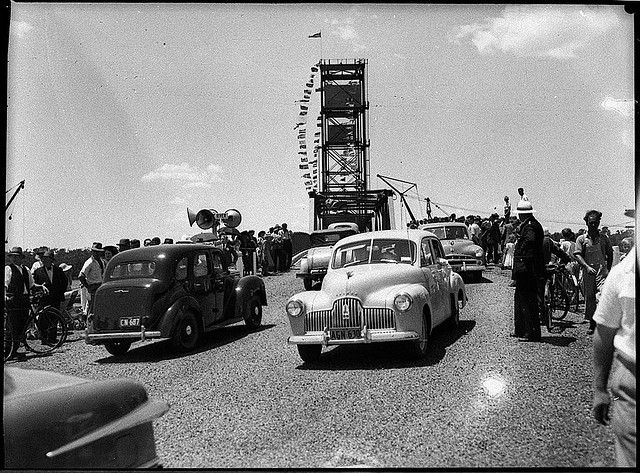 "[Holden crosses at the] opening of the Hexham Bridge, Newcastle, 17 December 1952 / Sam Hood    Holden 48/215 or FX model, ""Australia's own car"".    Find more detailed information about this photograph: acms.sl.nsw.gov.au/item/itemDetailPaged.aspx?itemID=31320    From the collection of the State Library of New South Wales www.sl.nsw.gov.au"