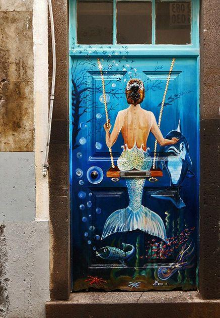Painted-door.-Mermaid-on-a-swing.-Madeira,-Portugal.