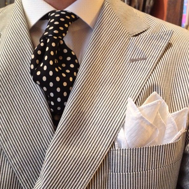 Seersucker double-breasted jacket, white shirt, navy tie with white polka dots