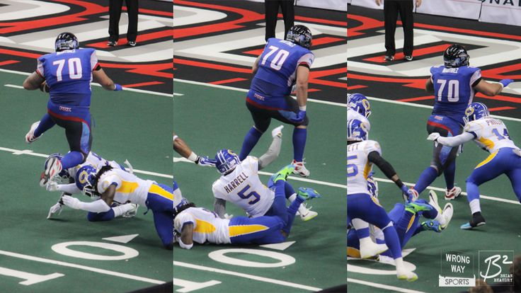 John Martinez hurdles two Tampa Bay Storm defenders on his way to the first touchdown of his career.