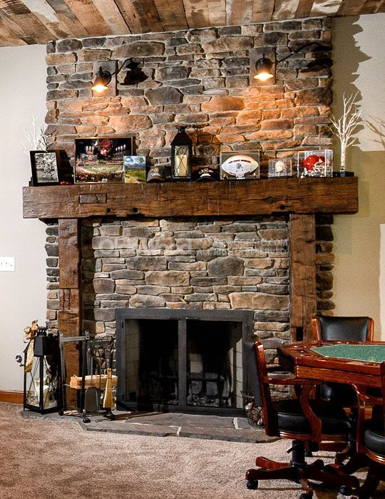RUSTIC Brick fireplace with large wood mantel.
