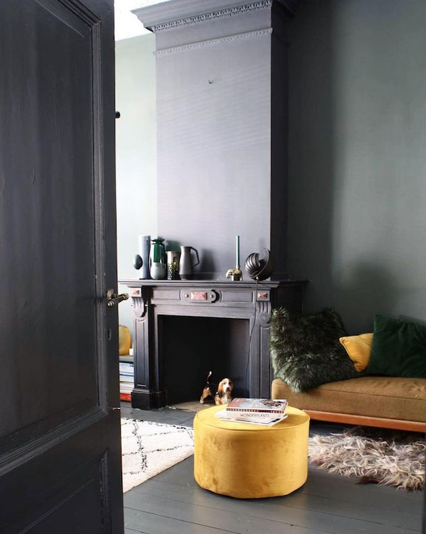 A fireplace in the home of collector Theo Bert Pot in rich, warm tones.