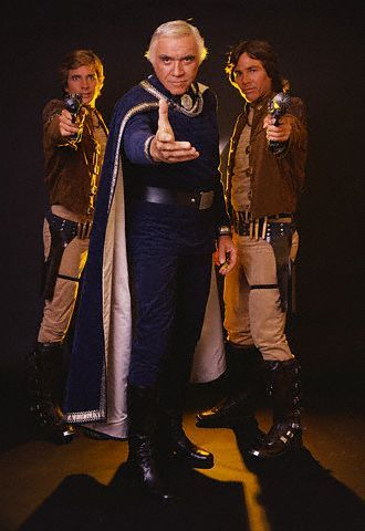 Lieutenant Starbuck, Commander Adama, and Captain Apollo (Dirk Benedict, Lorne Greene, Richard Hatch) from the original Battlestar Galactica (1978).