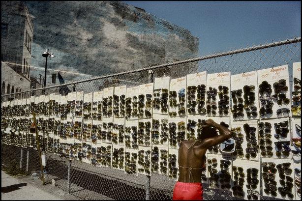 LOS ANGELES—A sunglasses street vendor at Venice Beach, 1982.  © Harry Gruyaert / Magnum Photos