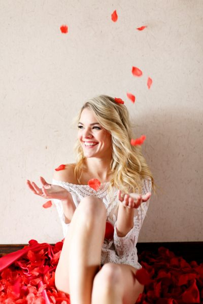 Rose petals are so fitting! http://www.stylemepretty.com/2014/03/19/bachelor-winner-nikki-ferrells-boudoir-session/ | Photography: Alea Lovely - http://alealovely.com/