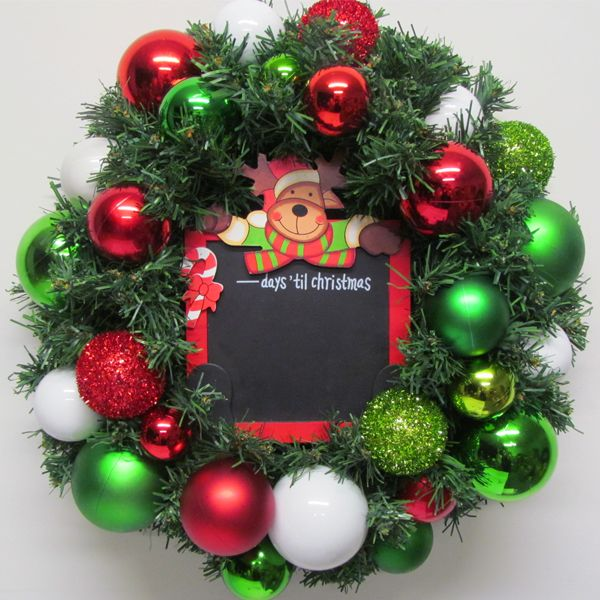 Have fun with the kids counting down to Christmas. This wreath features a blackboard surrounded by colourful baubles.