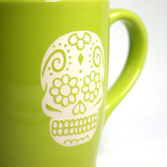Dia de los Muertos! We carved all the way through the light celery green glaze of this extra large mug so that the bold natural ceramic can be