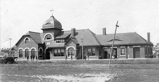 "The Santa Fe Passenger Depot in Arkansas City, Kansas, Built in 1888 and destroyed in 1950 to make room for a ""modern"" depot."