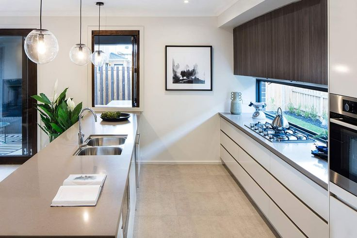 A stylish, modern kitchen is at the heart of this stunning home. #weeksbuildinggroup #homedesign #interiordesign #newhome
