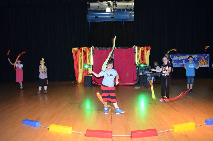 Children practicing circus skills towards the end of the week show for their families at Cedar Mount Academy, Manchester.  MagicalCircus.co.uk