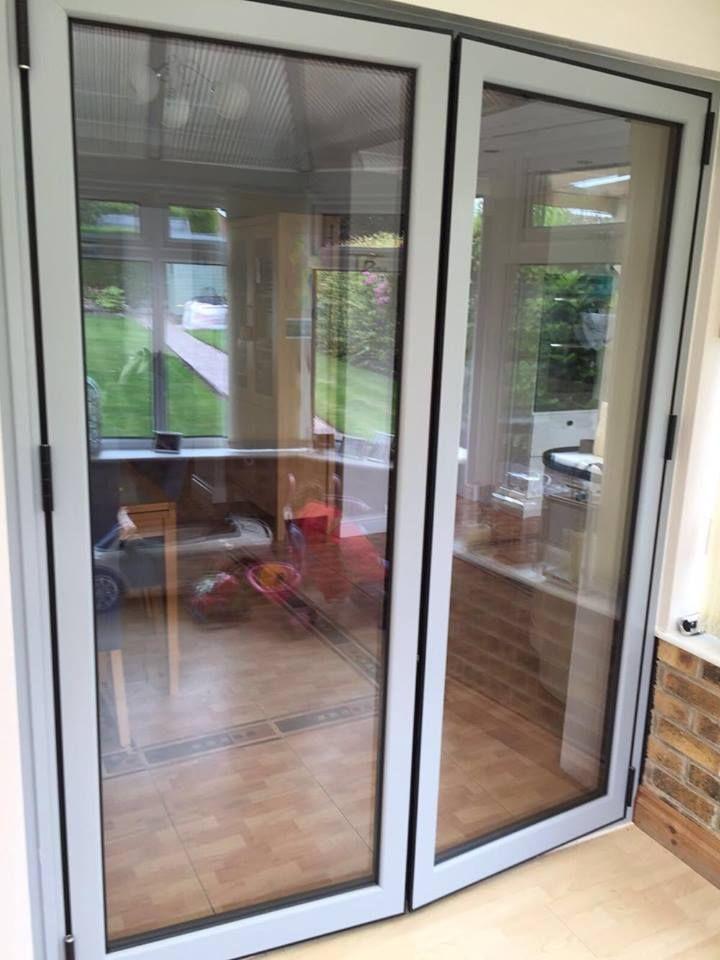 Two pane internal bi folding door colour ral7040 for Door window company