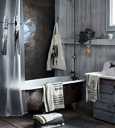 tin wall - bead board - claw foot tub - vintage sink and taps-minus the plastic shower curtain... Then...perfect!
