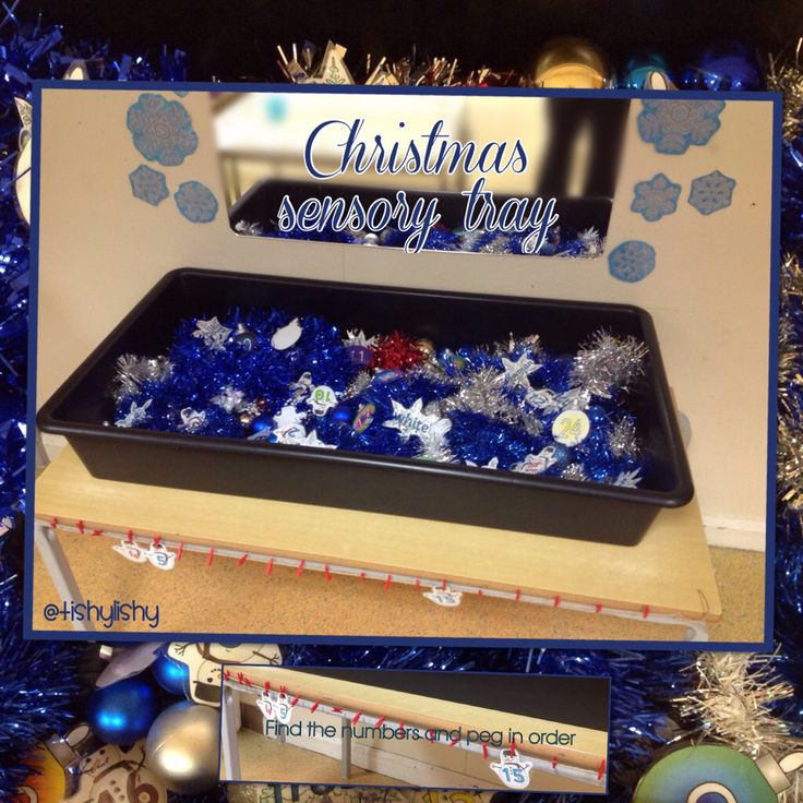 Sensory tray with baubles, tinsel and numbered snowmen and baubles.