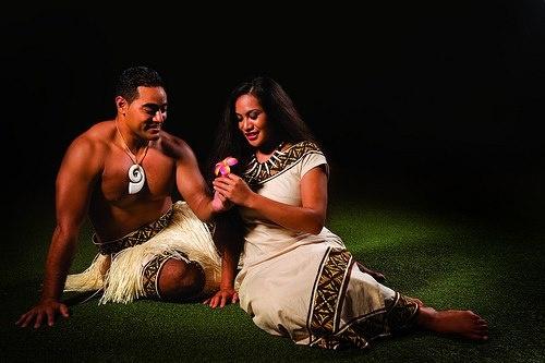 Polynesian women wearing flowers behind their ear. A ...  Polynesian wome...