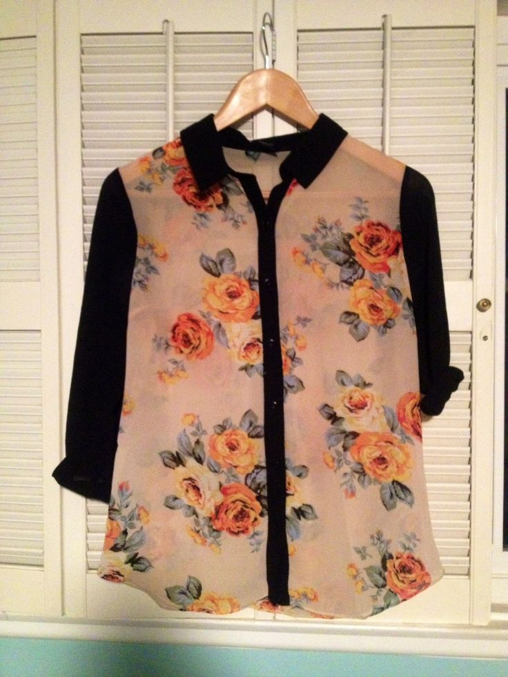 Button up sheer top from Forever21 size small. Floral torso with black sleeves and collar. 10 glitter