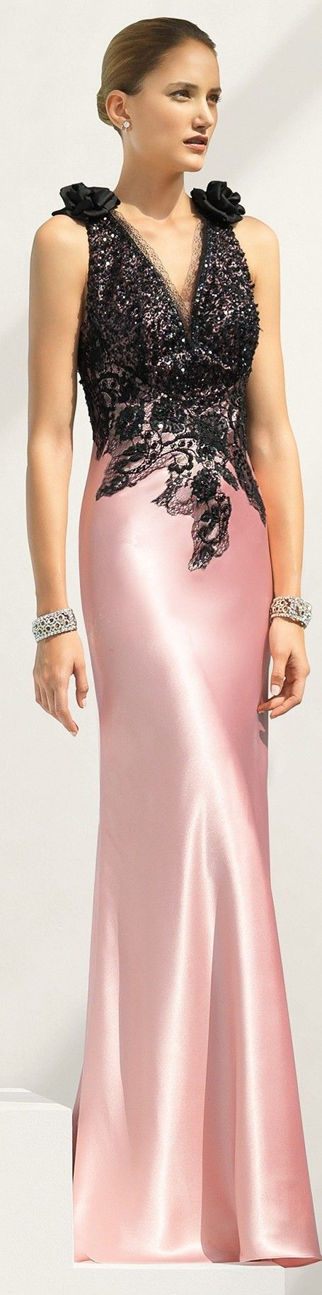 I love the beaded black bodice with the pink gown. Love the color combo.
