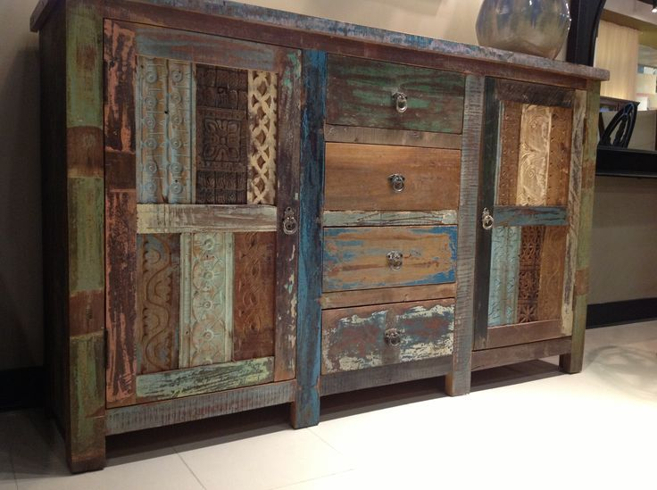 add this patchwork reclaimed wood dresser to your space for an eclectic and vintage appeal